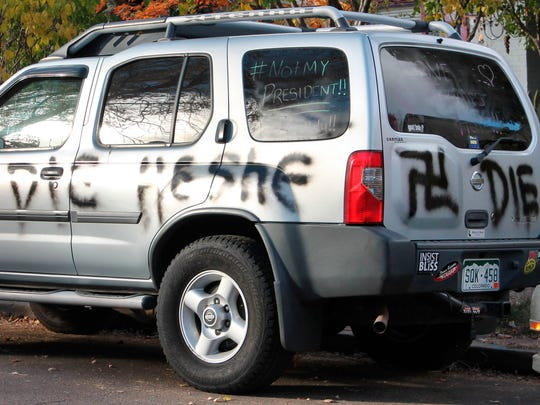 "This Wednesday, Nov. 16, 2016 photo provided by Denverite.com shows spray painted anti-transgender graffiti on the car of Amber Timmons, a transgender woman, in Denver. After the sweeping Republican election victory on Nov. 9, 2016, transgender people ""are concerned for their safety, survival and legal rights in the coming years,"" said Chase Strangio, an attorney with the American Civil Liberties Union who often works on transgender issues. (Ashley Dean/Denverite.com via AP)"