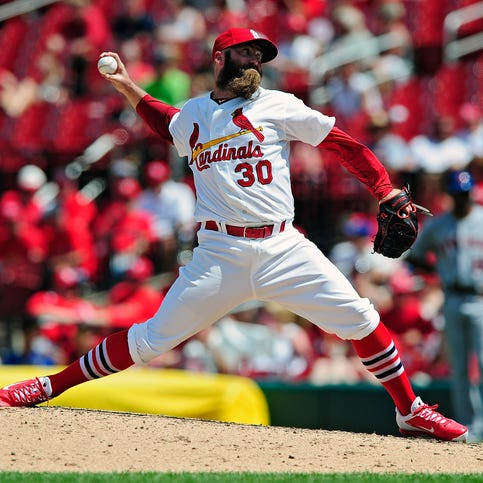 ST. LOUIS, MO - JUNE 18: Jason Motte #30 of the St. Louis Cardinals throws to a New York Mets batter during the ninth inning at Busch Stadium on June 18, 2014 in St. Louis, Missouri.  (Photo by Jeff Curry/Getty Images)