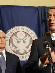 Conference Chairman Rep. Mike Pence, R-Ind., left, listens as Minority House Republican Leader John Boehner, R-Ohio, talks about the newly elected House Republican leadership at a news conference in Washington on Wednesday, Nov. 19, 2008. (Gannett News Service, Heather Wines)