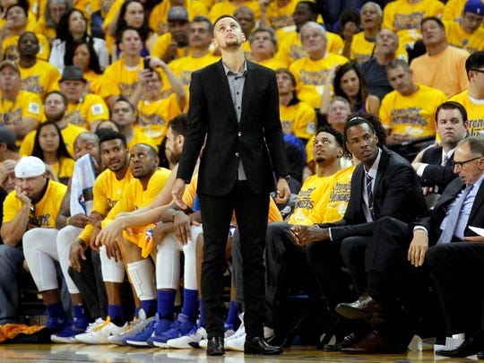 Golden State Warriors guard Stephen Curry looks up