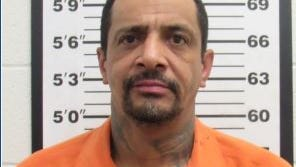 Jesus Navarro, 44, was charged with an open count of murder, tampering with evidence and intimidating a witness.
