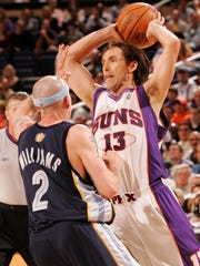 Suns guard Steve Nash looks to pass around Grizzlies