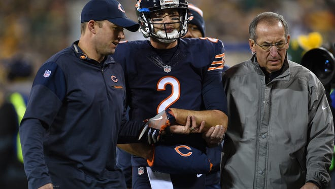 Quarterback Brian Hoyer of the Chicago Bears walks off of the field after being injured in the second quarter against the Green Bay Packers at Lambeau Field on October 20, 2016 in Green Bay.