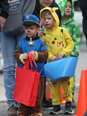 Trick-or-treaters wait in line for candy during the Tom Green County Sheriff's Office's second annualHalloween Trunk or Treat Tuesday, Oct. 31, 2017.