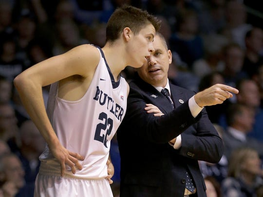 Butler Bulldogs head coach Chris Holtman talks with guard Sean McDermott (22) in the second half of their game Wednesday, November 16, 2016, at Hinkle Fieldhouse. The Butler Bulldogs defeated the Northwestern Wildcats 70-68.