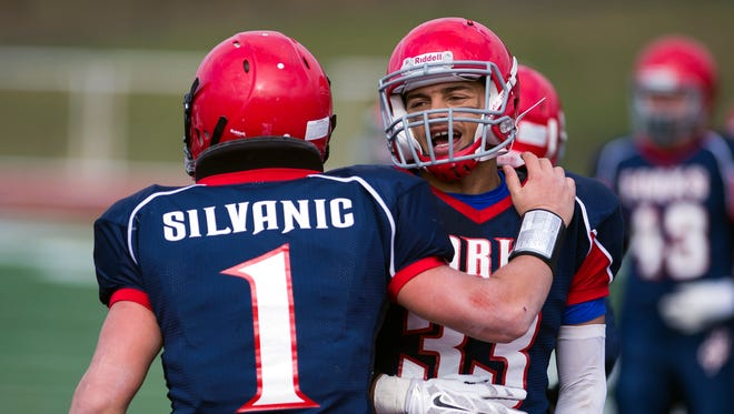 Chenango Forks running back L.J. Watson, right, celebrates with quarterback Tony Silvanic's touchdown during the Blue Devil's 35-8 win over Utica Notre Dame.