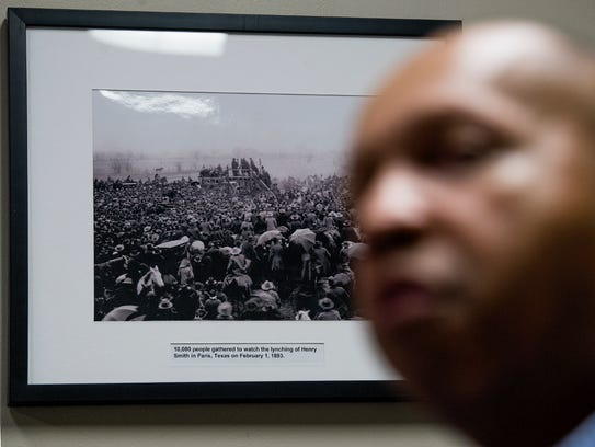 """A photo of a lynching in Paris, Texas hangs on the wall as Bryan Stevenson, Executive Director of the Equal Justice Initiative, talks at the EJI offices in Montgomery. """"Lynchings were meant to spread fear, that black people would fear something violent or bad would happen to me,"""" Stevenson said."""