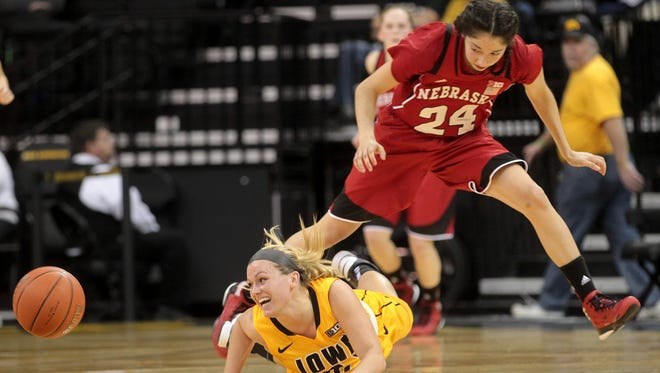 Iowa's Melissa Dixon gets fouled by Nebraska's Rachel Theriot during their game at Carver-Hawkeye Arena on Monday, Feb. 11, 2013.