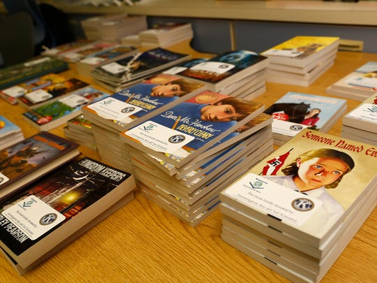 Books for fifth-graders are displayed on a table Tuesday for students at Apache Elementary School in Farmington.