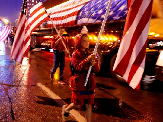 Participants march down Main Street July 4, 2015, during the Freedom Days Electric Light Parade in Farmington.