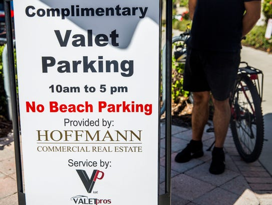Hoffmann Commercial Real Estate is starting new initiatives to ease parking in downtown Naples, including opening parking lots and adding more valet stands. Parking options are pictured in downtown Naples on Tuesday, Jan. 30, 2018.