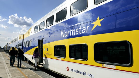 Passengers board an afternoon Northstar train at the Big Lake station.