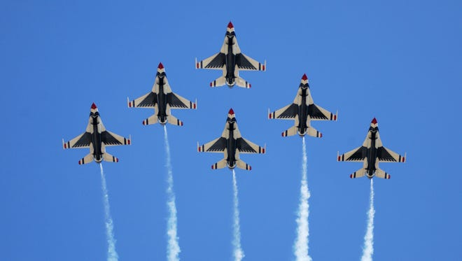 "The Air Force Thunderbirds will headline the 2014 Luke Days Open House and Air Show. ""Lighting in the Desert"" will feature aerial performances by the Deer Valley Warbirds, Wings of Blue and more on March 15-16, 2014.  Credit: U.S. Air Force photo."