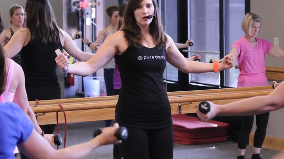 Instructor Katie Lowder at Pure Barre in Montgomery, Ala. on Wednesday February 27, 2013. (Montgomery Advertiser, Mickey Welsh)