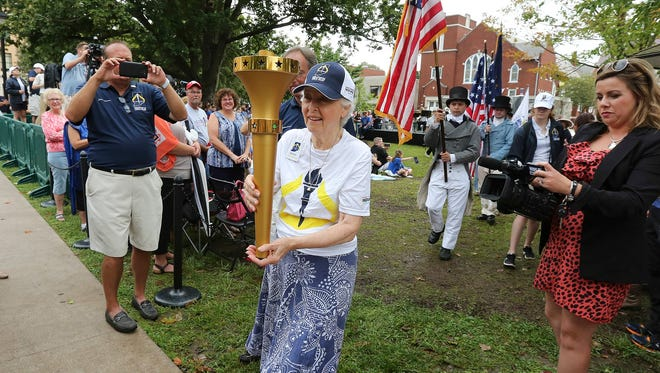 Former First Lady Judy O'Bannon carries first leg bicentennial torch relay in Corydon.