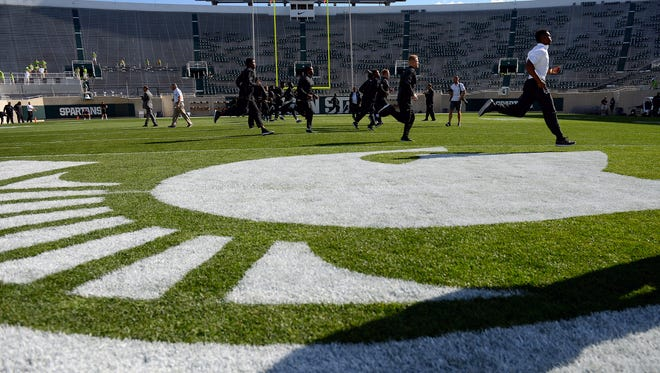 The Michigan State football team runs a couple warm up drills on the field before their opening game against Furman Friday, Sept. 2, 2016 at Spartan Stadium in East Lansing.