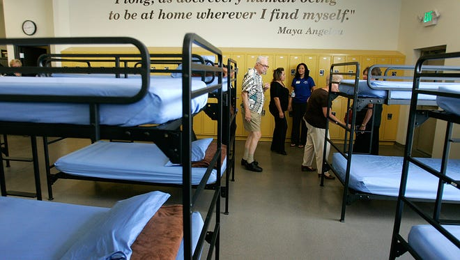 A group tours Roy's Desert Resource Center in 2010.  The homeless shelter is closing in June and is working to find its remaining residents a place to live.