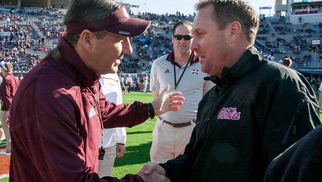 Head Coaches Hugh Freeze and Dan Mullen meet before the 2016 Egg Bowl.