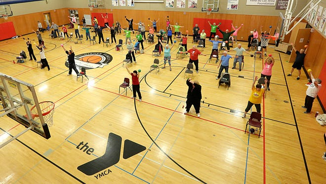 A group of senior citizens get together during an exercise class at the Fond du Lac Family YMCA.