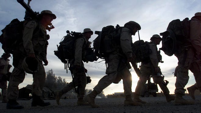 U.S. Marine prepare to board transport helicopters at the U.S. military compound in Kandahar, Afghanistan: For most of this conflict, there have been more contractors working on U.S. contracts than there have been U.S. military personnel in the country.