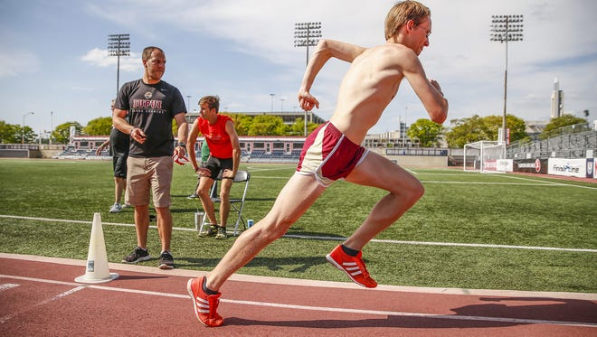 During practice on April 25,  Evan Fruits, IUPUI assistant men's track coach, started runner Robert Murphy after his teammates because of his speed.