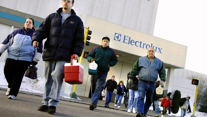 Day-shift workers cross 33rd Avenue North as they leave the Electrolux plant in St. Cloud in this 2008 file photo.