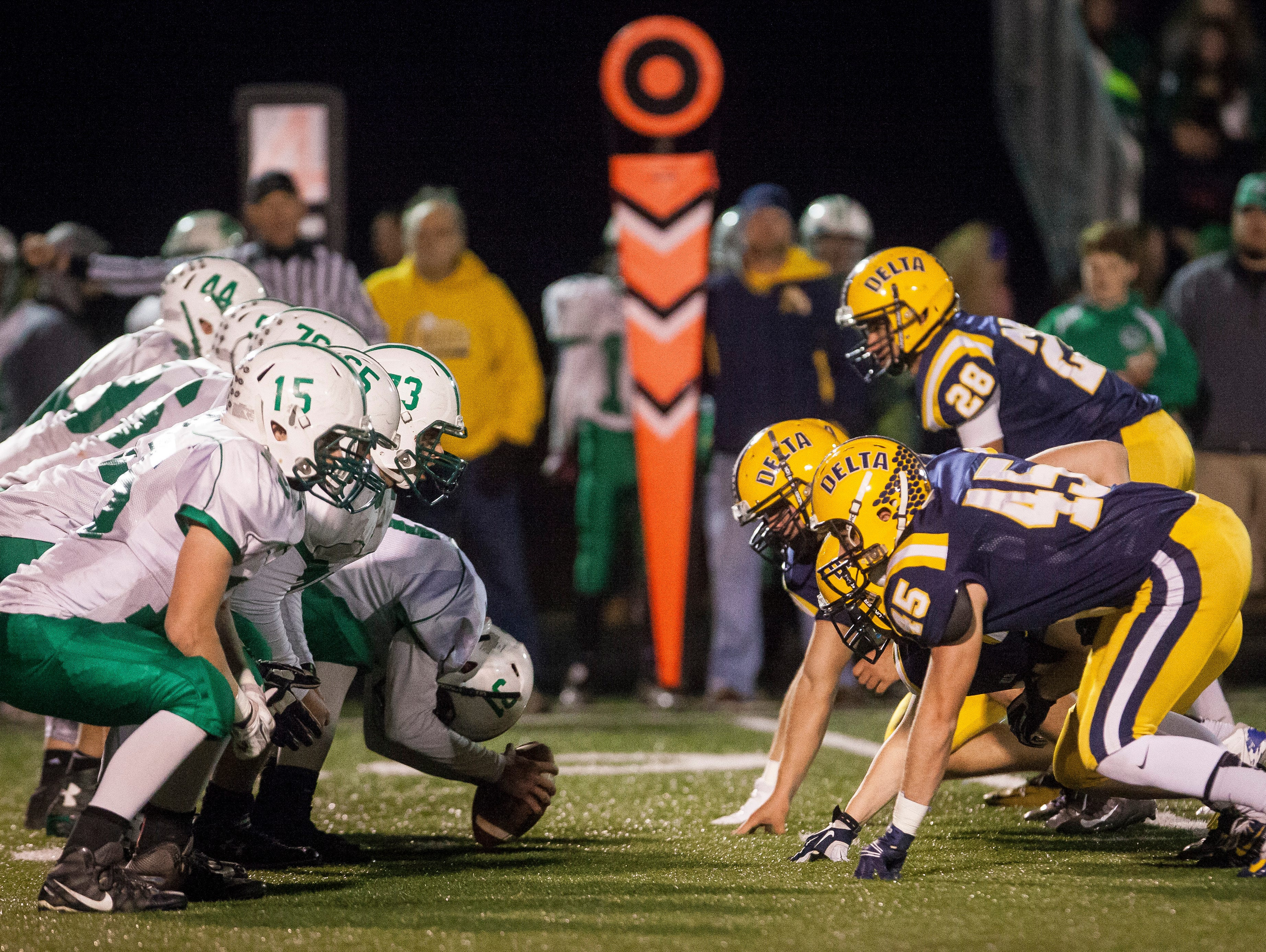 Delta's defense squares off against New Castle's offensive line Friday night at Delta. Delta won 49-7.