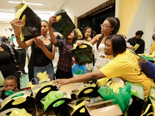 Taft High School seniors look for their gift bags as