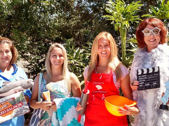 Local Make-A-Wish office dresses as their personal wishes. From leftv to right: Tammy Lynn, Taylor Marini, Janey Cook and Lesley Colantonio.