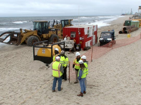 The sand replenishment crew is shown at 7th Avenue in Ortley Beach Tuesday, May 30, 2017.