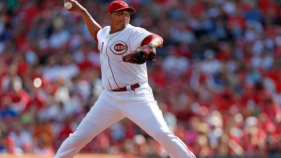 The Reds' Alfredo Simon throws against the Milwaukee Brewers during the first inning at GABP on May 4.