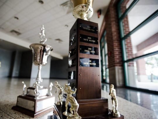 The Hanover Area Division I Cup is photographed next to the Hanover City Cup, background, at South Western High School. The Mustangs competed for the division cup against Spring Grove and New Oxford from 1996 to 2011.