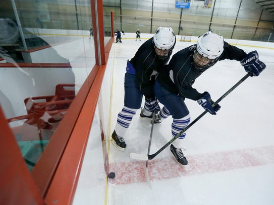 Matt Bosch and Devin Greek battle try to take possession