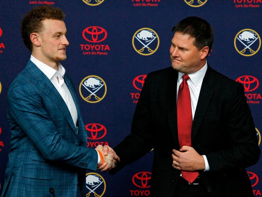FILE - In this Oct. 4, 2017, file photo, Buffalo Sabres forward Jack Eichel, left, and general manager Jason Botterill shake hands before an NHL hockey news conference in Buffalo, N.Y. If there's anything Botterill can draw upon from his experience with the Penguins, is seeing the notable difference between what makes up a winning organization such as Pittsburgh, and a losing one in a Sabres team that finished last for the third time in five years.   (AP Photo/Jeffrey T. Barnes)