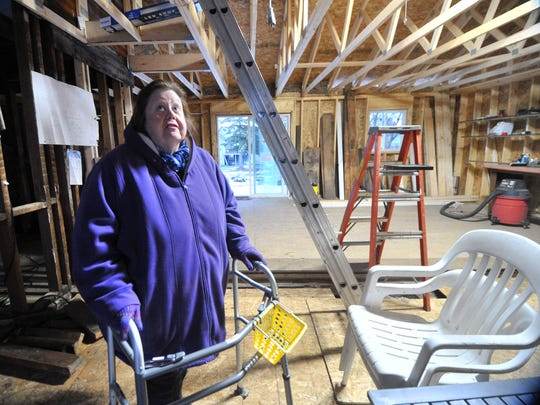 Cathy Smith,of Wausau, takes a tour her future home Wednesday in Wausau.