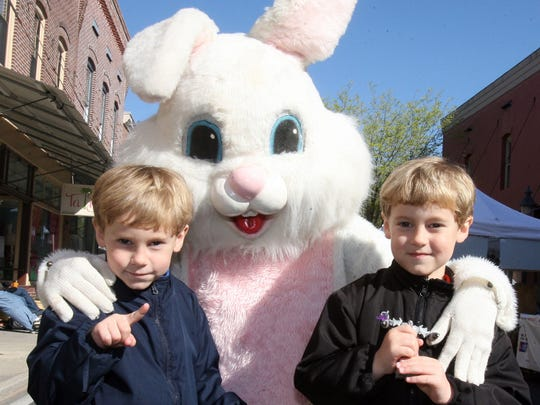The Easter Bunny greets twins Ethan, left, and Eddie Quick, 5, of Willards during the 17th annual Berlin Spring Celebration.