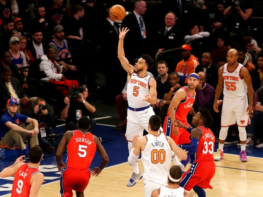 New York Knicks' Courtney Lee, center, puts up a shot