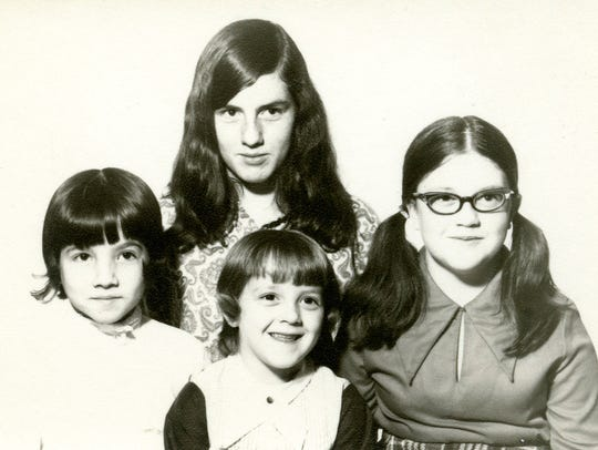 Debbie Oberg (top center) is shown here with her sisters,