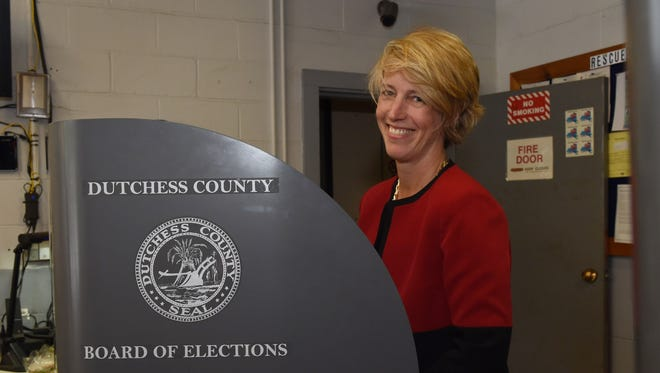 Zephyr Teachout, candidate in the Democratic Congressional primary for the 19th district looks up before filling in her ballot at the East Clinton Fire District in Clinton Corners on Tuesday.