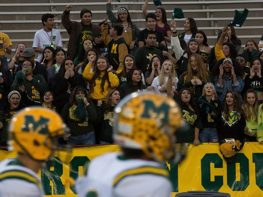 Mayfield High School fans cheer as the Trojans come