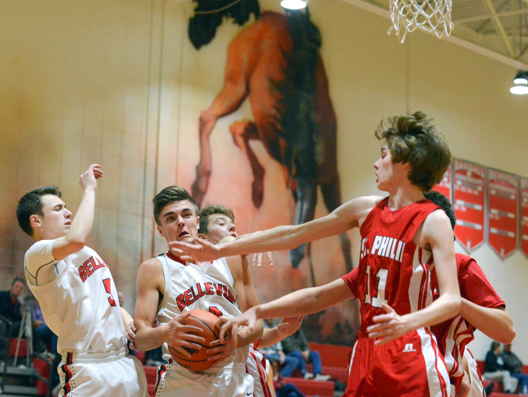 St. Phillip and Bellevue players battle for a rebound.