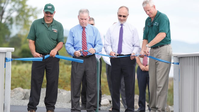 Rockland Co. Park Operations Mamager Mike Dimola, County Executive Ed Day, Faciliies Director Bob Gruffi and Division of Environmental Resources Coordinator Allan Beers, cut the ribbon at the opening of the 9/11 Memorial pedestrian bridge at Haverstraw Bay County Park in Haverstraw on Friday, September 09, 2016.