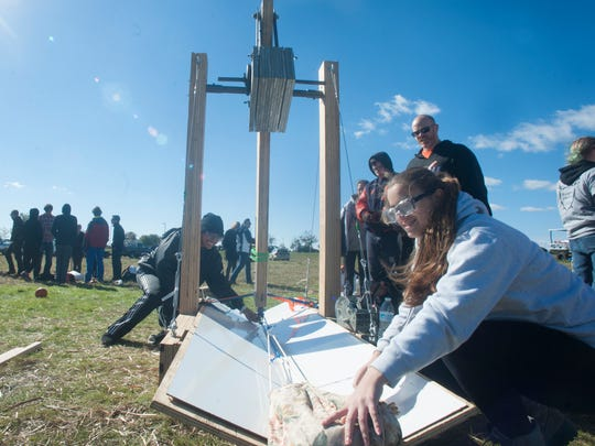 Millville High School, Hailey Holmes, left, and Chrissie Zimmerman, set their catapult during Rowan University chapter of American Society of Mechanical Engineers  13th annual Pumpkin Chunkin'.