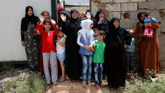 Syrian women are shown at their refugee camp June 13, 2018, in Lebanon. Lebanon is home to more than a million Syrian refugees, or about a quarter of the country's population, putting a huge strain on the economy.