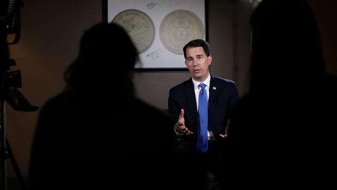 Gov. Scott Walker talks with USA TODAY NETWORK-Wisconsin reporters in Green Bay March 16.