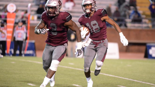 Liberty Tech's Alec Long runs ahead of his teammate Rodney Castille during the TSSAA Class AAA Championship game against Alcoa, Friday evening in Cookeville. Alcoa defeated Liberty, 45-12.