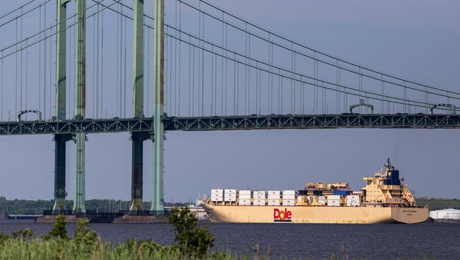 The container ship Dole Colombia makes its way up the Delaware River in 2014. The Delaware River and Bay Authority plans to install a $43 million fender system at the bridge to protect it from collisions with large vessels.