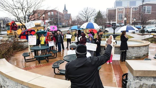 Ricky Bugg Sr. addresses the people as members of the Annville Township community and members of Lebanon Valley College held a march and rally to end racism on Tuesday, Feb. 7, 2017. The march and rally was in response after Chris Behney, founder of Just Wing It, used a racial slur against an African American Lebanon Valley College student on Sunday, Jan. 22, 2017.