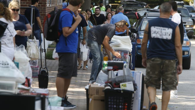 Belongings are piled outside Russell Hall and other dormitories as freshmen move in to their dorms on the University of Delaware campus in this 2015 file photo.