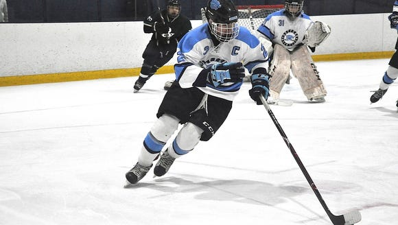 Suffern's Trevor Gagliano breaks the puck up ice..